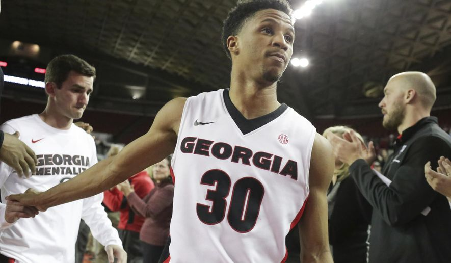 Georgia guard J.J. Frazier (30) walks off the court after the team's loss to Belmont in an NCAA college basketball game in the NIT in Athens, Ga., Wednesday, March 15, 2017. Belmont defeated Georgia 78-69. (John Roark/Athens Banner-Herald via AP)