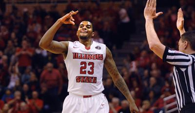 Illinois State forward Deontae Hawkins (23) celebrates after sinking a 3-point shot against UC Irvine during an NCAA college basketball game in the first round of the NIT on Wednesday, March 15, 2017, in Normal, Ill. (David Proeber/The Pantagraph via AP)