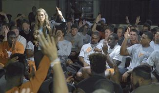 "In this Oct. 17, 2016, photo provided by Women Rising, ProtectHer founder Alexis Jones speaks to members of the University of Texas football team, in Austin, Texas. Jones, an author, activist, public speaker and former contestant on the television show ""Survivor,"" has been speaking to college football teams around the country for three years about the treatment of women. Her goal is to rebrand manhood.(Sara Hirsh Bordo/Women Rising via AP)"