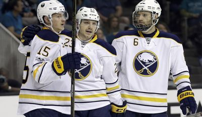 Buffalo Sabres' Jack Eichel (15) celebrates his goal with teammates Sam Reinhart, center, and Cody Franson (6) during the first period of an NHL hockey game, Tuesday, March 14, 2017, in San Jose, Calif. (AP Photo/Marcio Jose Sanchez)
