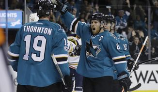 San Jose Sharks' Joe Pavelski (8) celebrates his goal with teammate Joe Thornton (19) during the second period of an NHL hockey game against the Buffalo Sabres Tuesday, March 14, 2017, in San Jose, Calif. (AP Photo/Marcio Jose Sanchez)