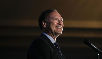 FILE- In this Feb. 11, 2017, file photo, Supreme Court Justice Samuel Alito smiles as he delivers a keynote speech at the Claremont Institute's annual dinner in Newport Beach, Calif. Alito said Wednesday, March 15, during a speech sponsored by a Catholic organization in New Jersey that the U.S. is entering a period when its commitment to religious liberty is being tested. (AP Photo/Jae C. Hong, File)