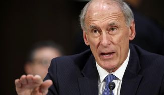 Director of National Intelligence Daniel Coats said in June that he spoke with the National Security Agency about extensive efforts to estimate how many Americans' information is snared by the government's foreign surveillance and concluded it was impossible to follow through. (Associated Press/File)