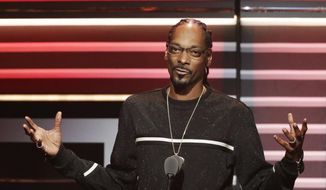 """In this Sept. 17, 2016, file photo, Snoop Dogg speaks while being honored with the """"I am Hip Hop"""" award at the BET Hip Hop Awards in Atlanta. Snoop Dogg's new music video, posted Monday, March 13, 2017, aims a toy gun at a clown dressed as President Donald Trump. The video is for a remixed version of the song """"Lavender,"""" by Canadian group BADBADNOTGOOD featuring Snoop Dogg and Kaytranada. (AP Photo/David Goldman, File)"""