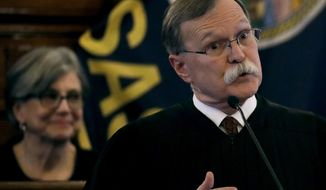Kansas Supreme Court Chief Justice Lawton Nuss speaks while Senate president Susan Wagle looks on during the annual State of the Judiciary address at the Statehouse in Topeka, Kan., Wednesday, March 15, 2017. (AP Photo/Charlie Riedel)
