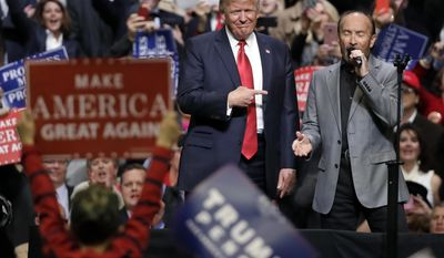 "President Donald Trump stands on stage with singer Lee Greenwood as Greenwood sings ""God Bless the USA"" at a rally Wednesday, March 15, 2017, in Nashville, Tenn. (AP Photo/Mark Humphrey)"