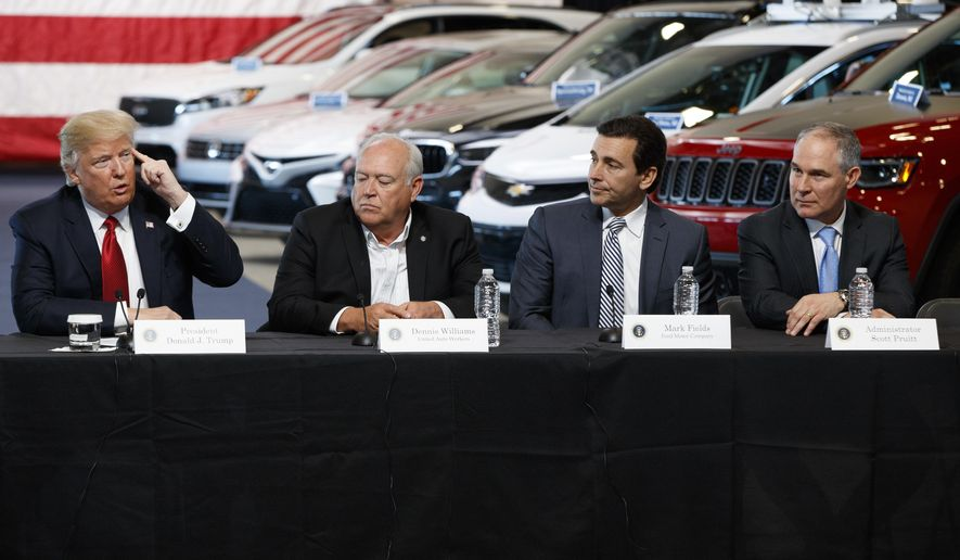 President Donald Trump speaks during a roundtable at the American Center of Mobility, Wednesday, March 15, 2017, in Ypsilanti Township, Mich. From left are, Trump, UAW president Dennis Williams, Ford CEO Mark Fields, and EPA administrator Scott Pruitt. (AP Photo/Evan Vucci)