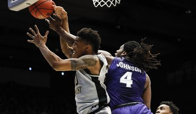 Wake Forest's John Collins, left, and Kansas State's D.J. Johnson (4) battle for a rebound in the second half of a First Four game of the NCAA college basketball tournament, Tuesday, March 14, 2017, in Dayton, Ohio. Kansas won 95-88. (AP Photo/John Minchillo)