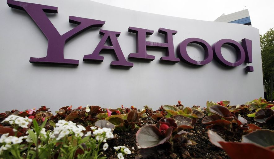 In this April 18, 2011 file photo, the Yahoo logo is seen outside of the offices in Santa Clara, Calif.  (AP Photo/Paul Sakuma, File)