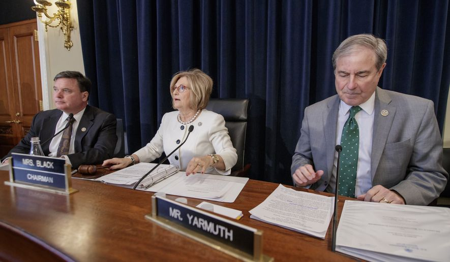 House Budget Committee Chair Rep. Diane Black, R-Tenn., center, flanked by the committee's ranking member, Rep. John Yarmuth, D-Ky., right, and Rep. Todd Rokita, R-Ind., holds a hearing on the Republican health care bill, Thursday, March, 16, 2017, on Capitol Hill in Washington. (AP Photo/J. Scott Applewhite)