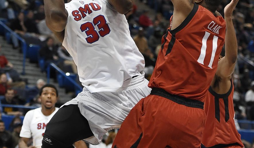 SMU's Semi Ojeleye shoots as Cincinnati's Gary Clark, right, defends during the second half of an NCAA college basketball game in the American Athletic Conference tournament final, Sunday, March 12, 2017, in Hartford, Conn. (AP Photo/Jessica Hill)