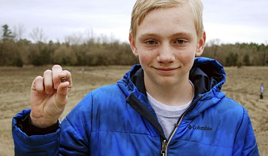 This Saturday, March 11, 2017, photo, provided by the Arkansas Department of Parks & Tourism shows Kalel Langford holding a 7.44 carat diamond he found at Crater of Diamonds State Park in Murfreesboro, Ark. Officials at the park said the diamond is the seventh largest found since the park was established in 1972. (Waymon Cox/Arkansas Department of Parks & Tourism via AP)