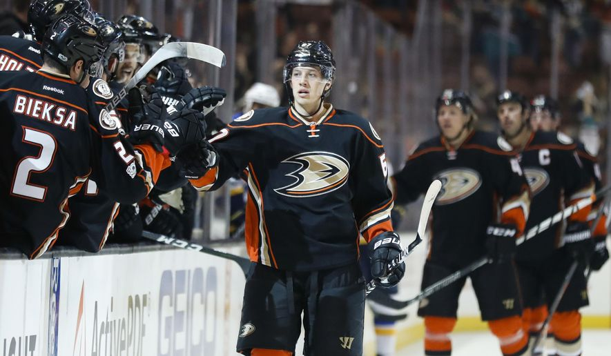 Anaheim Ducks' Rickard Rakell, center, of Sweden, celebrates his goal with teammate during the first period of an NHL hockey game against the St. Louis Blues, Wednesday, March 15, 2017, in Anaheim, Calif. (AP Photo/Jae C. Hong)