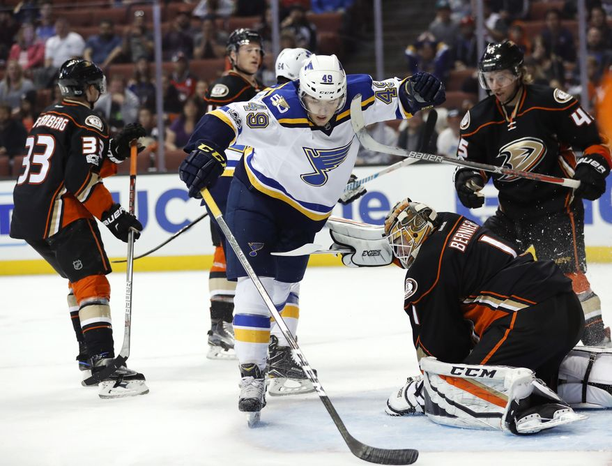 Anaheim Ducks goalie Jonathan Bernier, right, makes a save in front of St. Louis Blues' Ivan Barbashev, center, of Russia, during the first period of an NHL hockey game, Wednesday, March 15, 2017, in Anaheim, Calif. (AP Photo/Jae C. Hong)