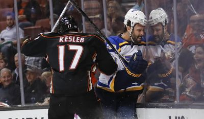 St. Louis Blues' Robert Bortuzzo, right, is checked by Anaheim Ducks' Ryan Kesler during the second period of an NHL hockey game, Wednesday, March 15, 2017, in Anaheim, Calif. (AP Photo/Jae C. Hong)