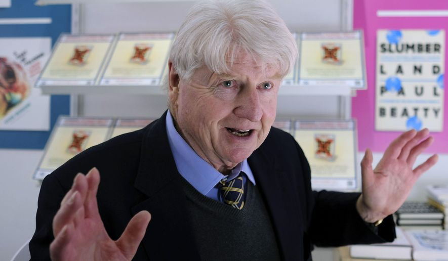 """Stanley Johnson poses for a portrait as he talks to the Associated Press at the London Book Fair, about his forthcoming thriller based around a fictitious Brexit scenario, in London, Thursday, March 16, 2017. In the political thriller """"Kompromat,"""" a political earthquake is shaking Britain and the European Union, a populist tide is sweeping the West and a resurgent Russia is pulling invisible strings. British author Stanley Johnson found gallons of real-life fuel for his forthcoming Brexit thriller. As a former senior EU official, and father of Brexit-backing British Foreign Secretary Boris Johnson, he's exceptionally well placed to turn political fact into fiction. (AP Photo/Alastair Grant)"""