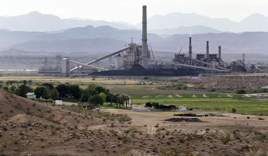 FILE - This May 14, 2012 file photo shows the Reid Gardner Generating Station near a farm on the Moapa Indian Reservation in Moapa, Nev. Environmental advocates and members of Moapa are hailing the closure of the Reid Gardner Generating Station. (AP Photo/Julie Jacobson, File)