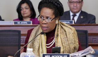 Rep. Sheila Jackson Lee, D-Texas, opposes the Republican health care bill during work by the House Budget Committee, on Capitol Hill in Washington, Thursday, March, 16, 2017. (AP Photo/J. Scott Applewhite)