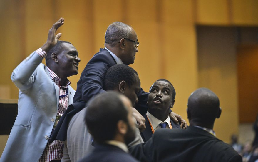 New president of the African soccer confederation Ahmad of Madagascar, center, is congratulated at the general assembly of the Confederation of African Football (CAF) in Addis Ababa, Ethiopia Thursday, March 16, 2017. Issa Hayatou was voted out as president of the African soccer confederation on Thursday after 29 years in charge, losing to challenger Ahmad of Madagascar in a major shakeup for the sport on the continent. (AP Photo)