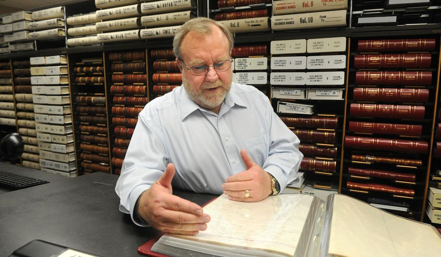 In this Feb. 22, 2017 photo, Taylor County Clerk Larry Bevill oversees the preservation of records at the Taylor County Courthouse in Abilene, Texas. (Nellie Doneva /The Abilene Reporter-News via AP)