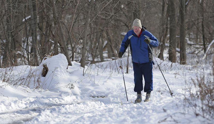 In a Jan. 5, 2016 photo, Charlie Frisk, a member of the Baird Creek Preservation Foundation, cross-country skis in the park. After 20 years, Frisk estimates the foundation has acquired and donated at least 80 acres to the 600-acre greenway that starts around Henry Avenue and fans out to the north and south as it approaches Huron Road and rural areas outside the city limits  (Jim Matthews/The Green Bay Press-Gazette via AP)
