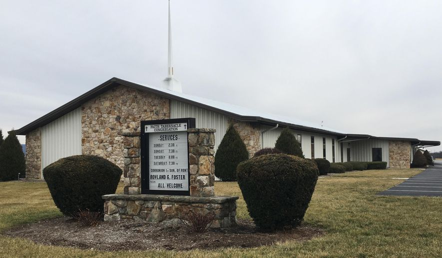 This Feb. 3, 2017, photo shows the Faith Tabernacle Congregation in Mechanicsburg, Pa. The church's pastor, the Rev. Rowland Foster, has been charged in connection with the pneumonia death of his granddaughter. (AP Photo/Michael Rubinkam)