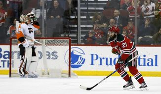 New Jersey Devils right wing Kyle Palmieri (21) skates back to his bench after scoring a goal past Philadelphia Flyers goalie Steve Mason during the first period of an NHL hockey game, Thursday, March 16, 2017, in Newark, N.J. (AP Photo/Adam Hunger)