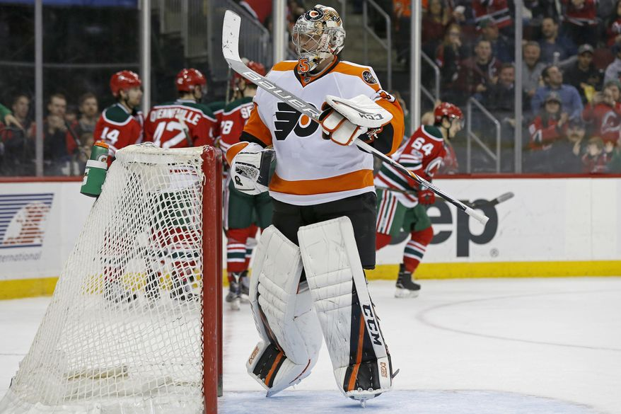 Philadelphia Flyers goalie Steve Mason reacts after giving up a goal to New Jersey Devils left wing Joseph Blandisi (64) during the second period of an NHL hockey game, Thursday, March 16, 2017, in Newark, N.J. (AP Photo/Adam Hunger)