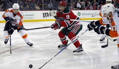 New Jersey Devils left wing Taylor Hall (9) battles for the puck between Philadelphia Flyers defenseman Andrew MacDonald (47) and Flyers defenseman Ivan Provorov (9) during the second period of an NHL hockey game, Thursday, March 16, 2017, in Newark, N.J. (AP Photo/Adam Hunger)
