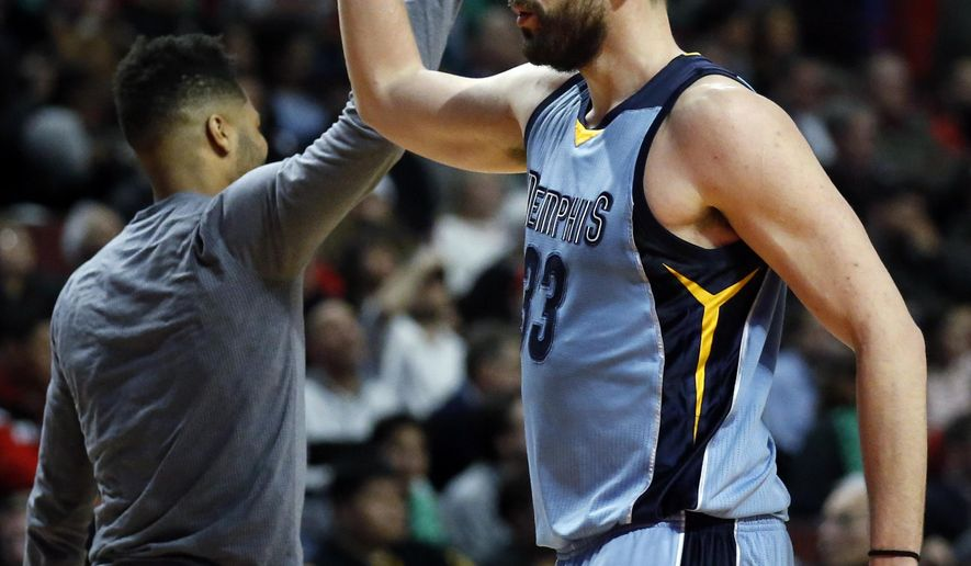 Memphis Grizzlies center Marc Gasol, right, celebrates with guard Andrew Harrison after making a three point basket during the second half of an NBA basketball game against the Chicago Bulls, Wednesday, March 15, 2017, in Chicago. The Grizzlies won 98-91. (AP Photo/Nam Y. Huh)