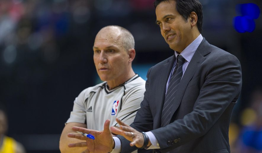 Miami Heat head coach Erik Spoelstra talks with a game official during the first half of an NBA basketball game against the Indiana Pacers, Sunday, March 12, 2017, in Indianapolis. (AP Photo/Doug McSchooler)
