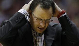 FILE - In this Feb. 12, 2017, file photo, Indiana head coach Tom Crean reacts during the second half of an NCAA college basketball game against Michigan, in Bloomington, Ind. Indiana coach Crean has been fired after five seasons. Athletic director Fred Glass announced the decision Thursday, March 16, 2017, as the NCAA Tournament was beginning.  (AP Photo/Darron Cummings, File)