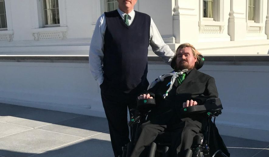 "In this photo provided by Sayreville Mayor Kennedy O'Brien, Patrick Sean O'Brien, who suffers from amyotrophic laterals sclerosis, or ALS, poses for a photo with his father Kennedy O'Brien, left, outside the White House on Thursday, March 16, 2017, in Washington. Kennedy O'Brien says the White House ""moved heaven and earth"" to get his 42-year-old son to Thursday night's dinner with President Donald Trump and Irish Prime Minister Enda Kenny. (Kennedy O'Brien via AP)"