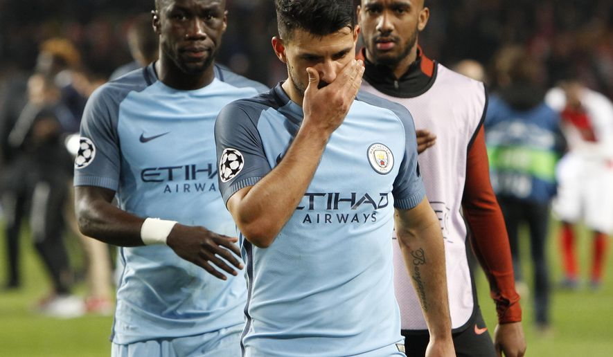 Manchester City's Sergio Aguero, center, leaves the pitch with teammates at the end of a Champions League round of 16 second leg soccer match between Monaco and Manchester City at the Louis II stadium in Monaco, Wednesday March 15, 2017. Midfielder Tiemoue Bakayoko's thumping header sent Monaco through to the Champions League quarterfinals as the home side beat Manchester City 3-1 on Wednesday to progress on the away goals rule in another pulsating match between two attack-minded sides. (AP Photo/Claude Paris)