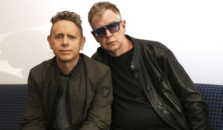 "In this March 8, 2017 photo, Martin Gore, left, and Andy Fletcher of Depeche Mode pose for a photo to promote their new album, ""Spirit."" Depeche Mode's 28-show North American tour will start in Salt Lake City in August. (AP Photo/John Carucci)"
