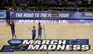 Duke head coach Mike Krzyzewski, top left, watches his team during basketball practice at the NCAA Tournament at Bon Secours Wellness Arena in Greenville, S.C., Thursday, March 16, 2017. For years, March brought the NCAA Tournament to North Carolina like a fixture of spring. And South Carolina watched from afar because of state politics that drew the ire of the NCAA. Those neighboring states have reversed roles this weekend.  (AP Photo/Chuck Burton)