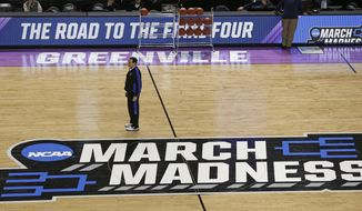 Duke head coach Mike Krzyzewski watches his team during basketball practice at the NCAA Tournament at Bon Secours Wellness Arena in Greenville, S.C., Thursday, March 16, 2017. For years, March brought the NCAA Tournament to North Carolina like a fixture of spring. And South Carolina watched from afar because of state politics that drew the ire of the NCAA. Those neighboring states have reversed roles this weekend.  (AP Photo/Chuck Burton)