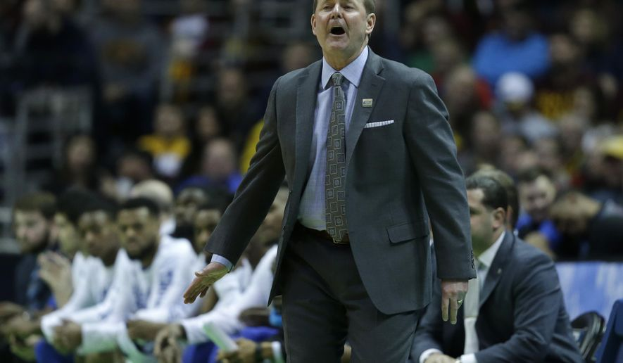Middle Tennessee head coach Kermit Davis reacts during the first half of an NCAA college basketball tournament first round game against Minnesota Thursday, March 16, 2017, in Milwaukee. (AP Photo/Kiichiro Sato)