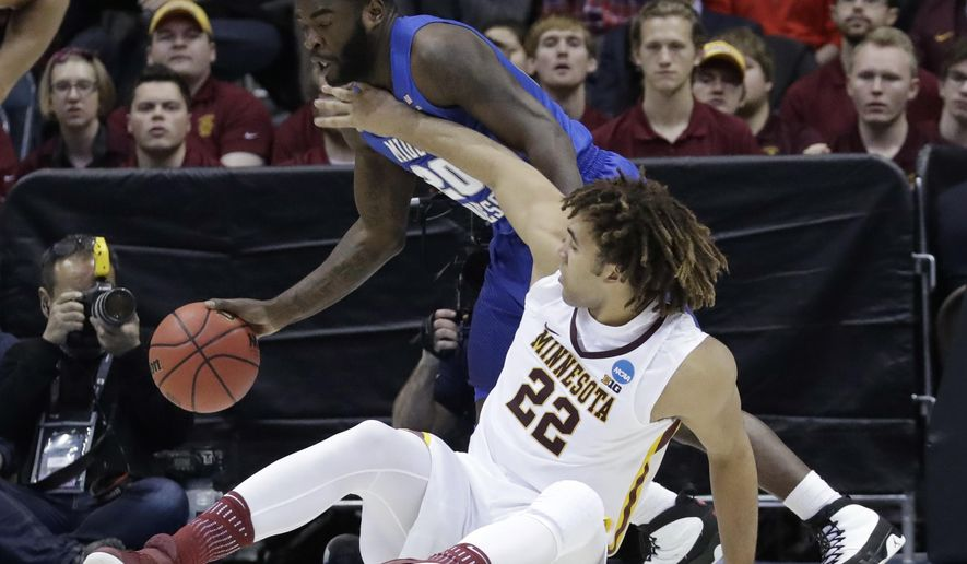 Middle Tennessee State's Giddy Potts (20) and Minnesota's Reggie Lynch battle for a loose ball during the second half of an NCAA college basketball tournament first round game Thursday, March 16, 2017, in Milwaukee. (AP Photo/Morry Gash)