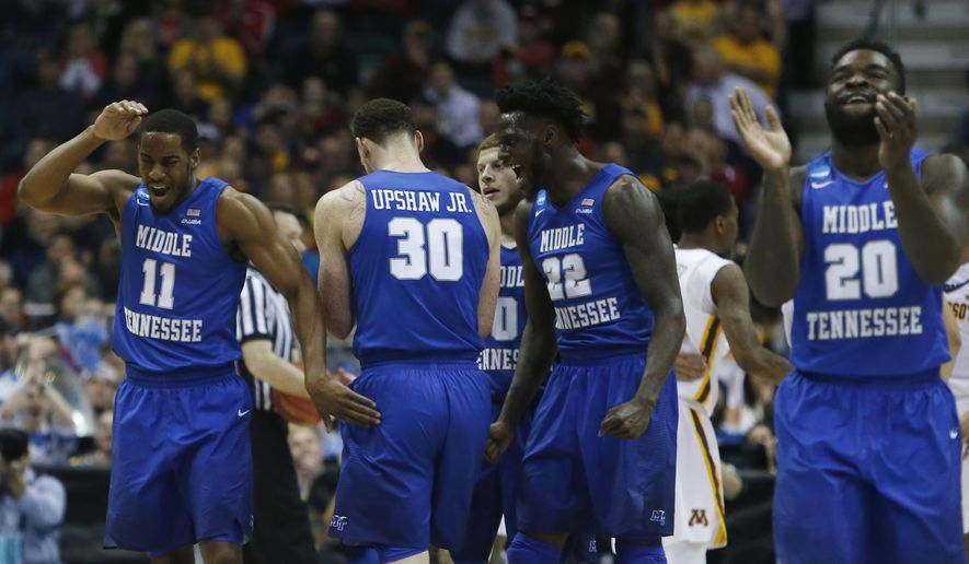 Middle Tennessee State players react during the second half of an NCAA college basketball tournament first round game against Minnesota Thursday, March 16, 2017, in Milwaukee. (AP Photo/Kiichiro Sato)
