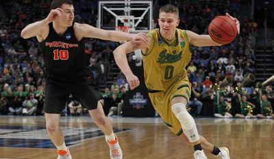 Notre Dame guard Rex Pflueger (0) drives past Princeton forward Spencer Weisz (10) during the first half of a first-round men's college basketball game in the NCAA Tournament, Thursday, March 16, 2017, in Buffalo, N.Y. (AP Photo/Jeffrey T. Barnes)