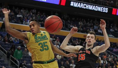 Notre Dame forward Bonzie Colson (35) and Princeton forward Steven Cook (25) go for the loose ball during the first half of a first-round men's college basketball game in the NCAA Tournament, Thursday, March 16, 2017, in Buffalo, N.Y. (AP Photo/Jeffrey T. Barnes)
