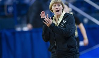 Purdue Head Coach Sharon Versyp claps during a practice at Purcell Pavilion in South Bend, Ind. Thursday, March 16, 2017 in advance of the first round of the NCAA Division 1 Women's Basketball Tournament hosted by Notre Dame. (Michael Caterina/South Bend Tribune via AP)