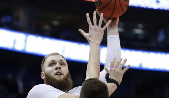 Gonzaga center Przemek Karnowski (24) shoots over South Dakota State forward Mike Daum (24) during the first half of a first-round men's college basketball in the NCAA Tournament, Thursday, March 16, 2017, in Salt Lake City. (AP Photo/George Frey)