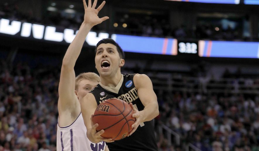 Vanderbilt guard Nolan Cressler (24) lays a shot in past Northwestern forward Nathan Taphorn (32) during the first half of a first-round men's college basketball game in the NCAA Tournament Thursday, March 16, 2017, in Salt Lake City. (AP Photo/George Frey)