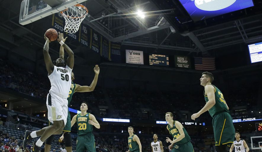 Purdue's Caleb Swanigan shoots during the first half of an NCAA college basketball tournament first round game against Vermont Thursday, March 16, 2017, in Milwaukee. (AP Photo/Kiichiro Sato)