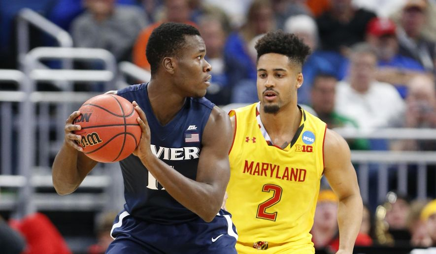Xavier guard Malcolm Bernard (11) looks for an opening past Maryland guard Melo Trimble (2) during the first half of the first round of the NCAA college basketball tournament, Thursday, March 16, 2017 in Orlando, Fla. (AP Photo/Wilfredo Lee)