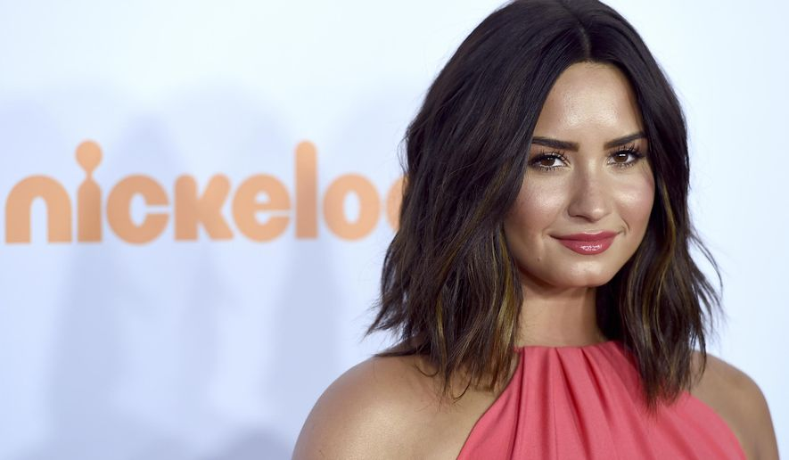 FILE - In this March 11, 2017,  file photo, Demi Lovato arrives at the Kids' Choice Awards at the Galen Center in Los Angeles. Lovato celebrated five years of sobriety on March 15, 2017, with an Instagram post. (Photo by Jordan Strauss/Invision/AP, File)