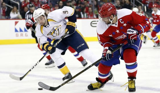 Nashville Predators left wing Filip Forsberg (9), from Sweden, pursues Washington Capitals left wing Alex Ovechkin (8), from Russia, who skates with the puck during the second period of an NHL hockey game, Thursday, March 16, 2017, in Washington. (AP Photo/Alex Brandon)