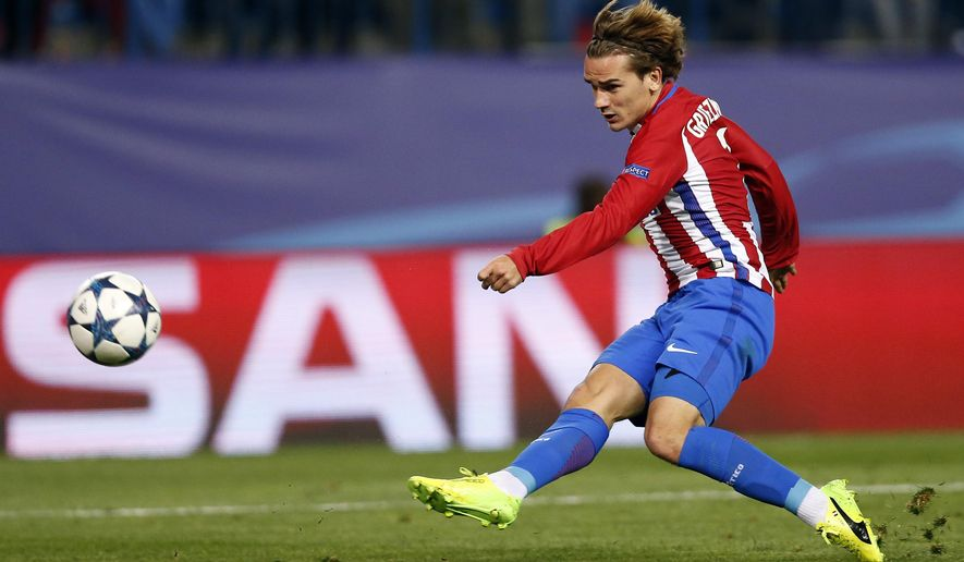 Atletico's Antoine Griezmann kicks the ball during the Champions League round of 16 second leg soccer match between Atletico Madrid and Bayer Leverkusen at the Vicente Calderon stadium in Madrid, Spain, Wednesday, March 15, 2017. (AP Photo/Daniel Ochoa de Olza)